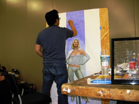 Frank Cho painting Emma Frost, Big Wow 2014